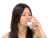 Woman drinking water isolated Stock Image