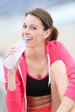 Woman drinking water after jogging Royalty Free Stock Photo