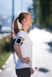 Woman drinking  water after  jogging Stock Photography