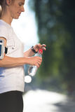 Woman drinking  water after  jogging Royalty Free Stock Image