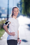 Woman drinking  water after  jogging Royalty Free Stock Photos
