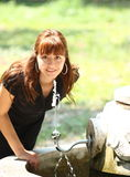 Woman drinking water outdoor Stock Photography