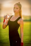 Woman drinking water outdoor on sunny day Royalty Free Stock Photo
