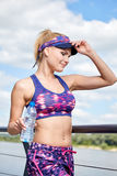 Woman drinking water after outdoor workout Stock Photography