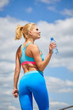 Woman drinking water after outdoor workout Stock Photos
