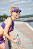 Woman drinking water after outdoor workout Royalty Free Stock Image