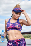Woman drinking water after outdoor workout Royalty Free Stock Photos
