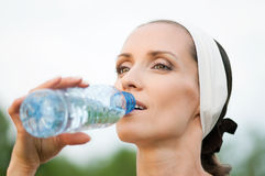Woman drinking water at outdoors sport Stock Photo