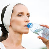 Woman drinking water at outdoors sport Royalty Free Stock Image