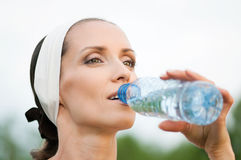 Woman drinking water at outdoors sport Stock Images