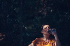 Woman drinking water outdoors Royalty Free Stock Images