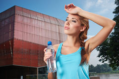 Woman drinking water at outdoors workout Stock Image