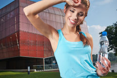 Woman drinking water at outdoors workout Royalty Free Stock Photography