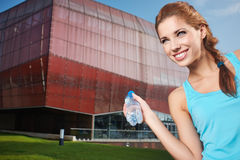 Woman drinking water at outdoors workout Stock Photography