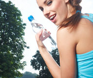 Woman drinking water at outdoors workout Royalty Free Stock Photo