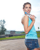 Woman drinking water at outdoors workout Stock Images