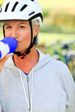 Woman drinking water in the park Royalty Free Stock Image
