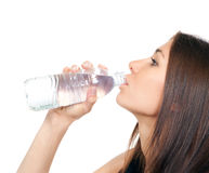 Woman drinking water from plastic bottle Royalty Free Stock Images
