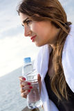 Woman drinking water after sport activities Royalty Free Stock Photo