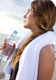 Woman drinking water after sport activities Royalty Free Stock Photos