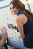 Woman drinking water after sport activities Stock Photo