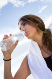 Woman drinking water after sport activities Royalty Free Stock Images