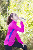 Woman drinking water after sports Royalty Free Stock Images