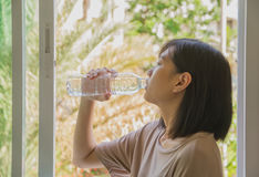 Woman drinking water in summer. Portrait of young woman drinking stock photos
