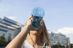 Woman drinking water. Thirsty woman drinking from a botte water Royalty Free Stock Image