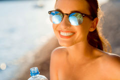 Woman drinking water from transparent bottle on Stock Photo