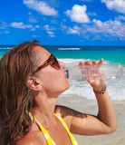 Woman drinking water Stock Photography