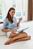 Woman Drinking Water, Using Computer, Working Home. Drink. Communication Stock Photos
