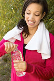 Woman drinking water after working out. Royalty Free Stock Image