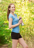 Woman drinking water after workout Stock Photos