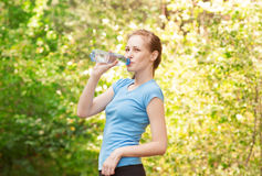 Woman drinking water after workout Stock Images