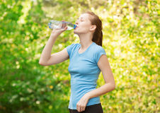 Woman drinking water after workout Royalty Free Stock Images