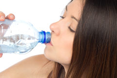 Woman drinking waterfrom glass Royalty Free Stock Images