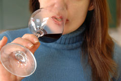 Woman drinking wine Stock Images