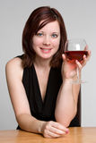 Woman Drinking Wine. Beautiful smiling woman drinking wine royalty free stock photography