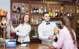 Woman drinking wine at counter Royalty Free Stock Images