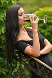 Woman drinking wine. Royalty Free Stock Image