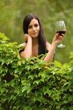 Woman drinking wine. Stock Photos