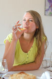 Woman is drinking wine Royalty Free Stock Photography