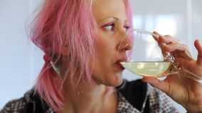 Woman drinking wine stock video footage