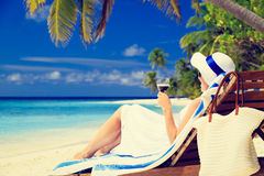 Woman drinking wine on tropical beach Royalty Free Stock Photos