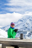 Woman drinking in winter mountain base camp Stock Photography