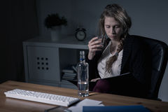 Woman drinking at work Stock Photos