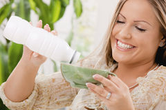 Woman drinking yogurt Royalty Free Stock Photos