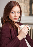 Woman drinking your morning coffee Royalty Free Stock Images