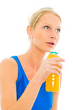 Woman drinks a  bottle of energy drink Stock Photo